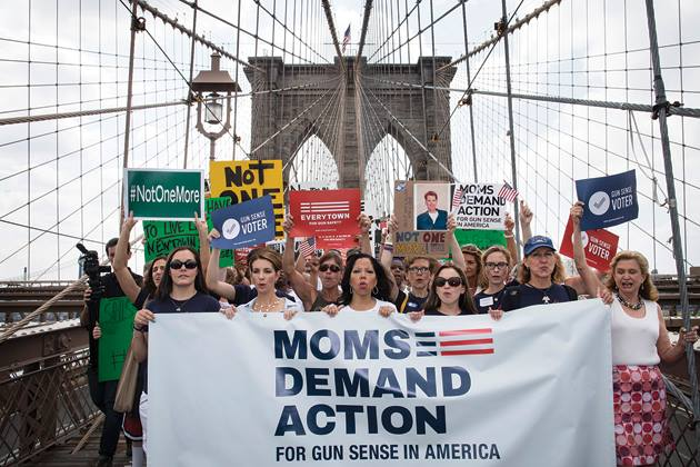Moms Demand Action marching over the Brooklyn Bridge