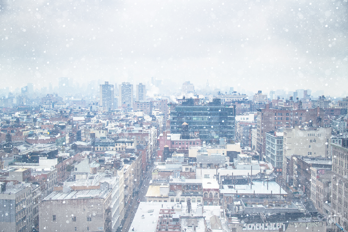 NYC Snowstorm - I used to work in a photo studio on Broadway near Canal Street, which had the most fantastic view North into the city. Every day the scene would change based on the weather, the clouds, and the atmosphere. I have dozens of photographs from this same perspective, but all with either beautiful, dramatic clouds, or photographed at night as long exposures. Usually photos of snow storms don't look so pretty. Somehow the stars aligned for me this one snowy January and I managed to capture a winter wonderland, 20 stories above the ground.