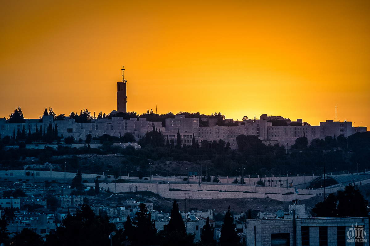 Jerusalem sunrise - I was visiting the Old City of Jerusalem with my wife, and we were staying right near the Damascus Gate, which is a main entrance to the Muslim Quarter. The few days we were there happened to fall on Eid Al Fitr, which is a high Muslim holiday. Our hotel had a balcony, and all night we heard music being blasted, horns honking, people clapping and playing in the streets. I sat up for most of the night just soaking in the sounds. At around 5am the sun started to peek over the mountains and lit up the sky in a golden way. I grabbed my camera, took a couple of photos [including the one here] and then walked down into the Old City, where I captured the next two images.