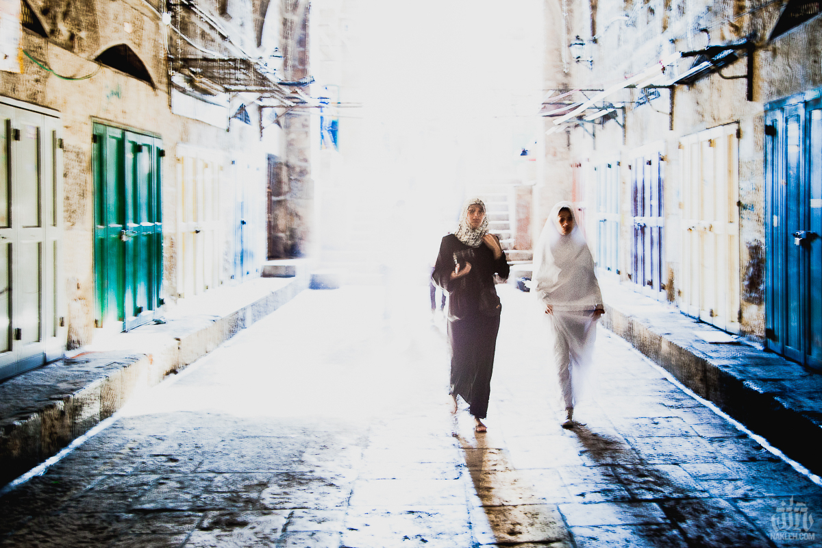 Two Women in Jerusalem - This photograph almost ended up deleted before I even got back to the hotel. I saw these two women approaching me while walking down a road in the Old City, and in my mind, I already envisioned the shot I was going to take. I pressed my camera to my eye, fired off a few frames, and they were gone. By the time I looked at my camera I only then realized I had the film speed set to the wrong setting, and the image was totally over exposed. Almost pure white. What did I do? I missed a good chance for a great photograph! Thankfully I didn't delete it right away, and when I got back I processed it through some fantastic RAW software that was magically able to pull out all of these amazing little details that I didn't know where there. The resulting image is ghostly, crusty, and magical- exactly how I remember the Old City.