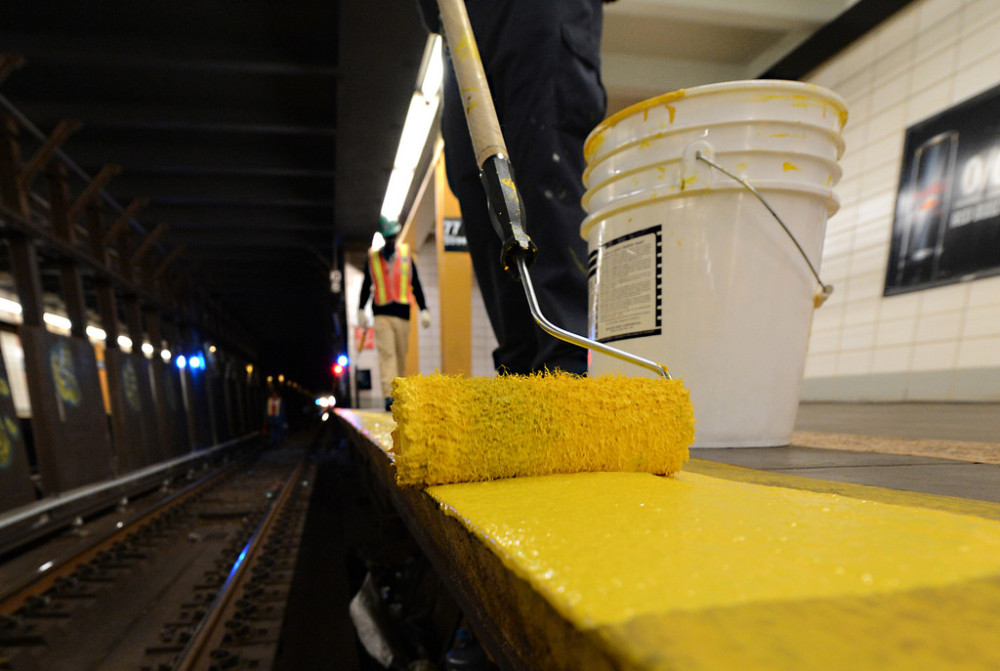 Fresh coat of paint applied to the platform rubbing board at 77 St during FASTRACK work in October 2014. Photo: Marc A. Hermann / MTA New York City Transit